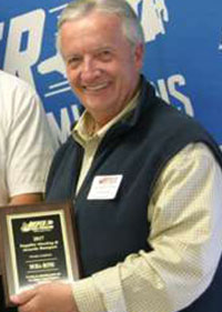 Chuck Barnett accepting an award